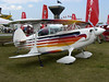 EAA Airshow 2006 : I took the following photos at EAA's AirVenture 2006. This is one of the World's largest general aviation events, and once a year Oshkosh Wisconsin's Wittman Field becomes the World's busiest airport.  This airshow and convention features people and planes from around the globe.  Aircraft of all kinds are represented here including:  antique/classics, warbirds, aerobatics, experimental homebuilts, ultralights, rotarywings, and many many more.  I tried to capture examples of as many of these types of aircraft as possible.  (Be sure to check out this great annual event in person if you get the chance!)